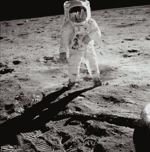 Apollo 11 photo: AS11-40-5903 . Buzz Aldrin with Neil Armstrong reflected in his visor.